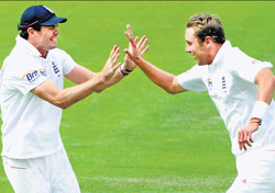 master and his protege: James Anderson (left) has taken over the responsibility of guiding young turks such as Stuart Broad. AFP