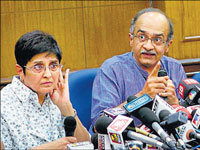Civil Society members Prashant Bhushan and Kiran Bedi address a press conference in New Delhi on Thursday. PTI