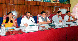 Assembly Speaker K G Bopaiah, Zilla Panchayat President Ravi Kushalappa, in charge Deputy Commissioner K M Chandre Gowda and others at a district-level review meeting held at Old Fort Hall premises in Madikeri on Saturday. DH Photo