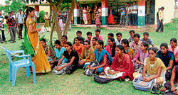 Classes being held for the degree students at the open space at the school premises in Kuderu village near Santhemarahalli in Chamarajanagar district. Dh photo