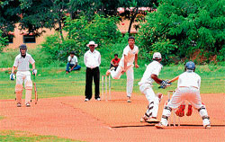 Match: Players of TTL College (batting) and Yuvaraja's (bowling) engaged in the Twenty 20 Inter-college Cricket Tournament at Manasagangothri in Mysore on Friday. DH Photo