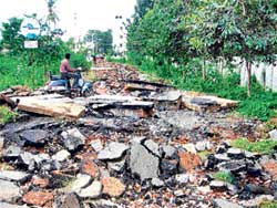 Cut-off: The main in road in Jnanabharati Layout reduced to shambles by the original owner of the land. DH Photo
