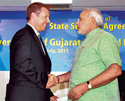 Gujarat Chief Minister Narendra Modi shakes hands with Joe Hinrichs, President, Ford Asia Pacific and Africa, during signing of an agreement between the company and the state  government in Gandhinagar. PTI