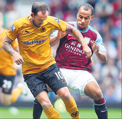 Steven Fletcher of Wolverhamton Wanderers (left) vies for the ball with Gabriel Agbonlahor of Aston Villa during their English Premiership match on Saturday. AFP