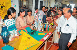 Experiments: A chemical spurts out of a test tube even as student demonstrates an experiment at the day-long science exhibition organised at MMK and SDM College for Women in Mysore on Friday