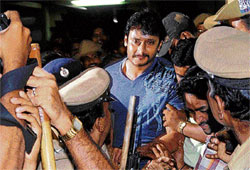 real action: (clockwise from top left) A television grab of Darshan's wife Vijayalakshmi at the hospital. Darshan arrives at the residence of the judicial magistrate in Kormangala. DH Photo