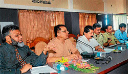 KMDC Secretary Atheeq Ahmed (Left) addressing the gathering at a grievance meet` convened by KMDC Chairperson Anwar Mannippady in Mangalore on Tuesday. Deputy Commissioner Dr N S Channappa Gowda, Police Commissioner Seemanth Kumar Singh and SP Labhu Ram are seen.DH photo