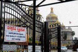 Admission restricted: Gates at the Vidhana Soudha sport banners imposing new restrictions on entry.   Photo