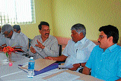 Chief minister's joint secretary Nandakumar, MLA C S Puttaraju, deputy commissioner P C Jaffer and CEO Jayaram at a meeting of Melkote Development Committee at Melkote on Tuesday. DH Photo