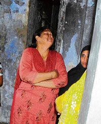 Riot victim Rupa Modi breaks down in her house at Gulberg Society while Modi was on a fast. PHOTO-K Bhadwad