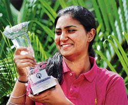 Eyeing more: Mehar Atwal with her trophy after winning the Ladies Amateur golf title on Thursday. AFP
