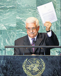 Palestinian President Mahmoud Abbas holds a letter requesting recognition of Pa­le­s­tine as a State as he addresses the 66th session of the United Nations General Assembly on Friday. AP