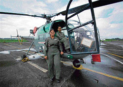 Flying factor: Filght Lt Poornima Ranade (left) and  Lt Arunima, members of relief operation team at the IAF base in Bagdogra, on Saturday.  PTI
