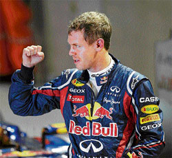 German wonder Red Bull's Sebastian Vettel shows his happiness after claiming yet            another pole in the Singapore Grand Prix on Saturday. AFP