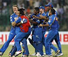 Mumbai Indians players and support staff celebrate their win over Trinidad and Tobago in their Champions League Twenty20 cricket match in Bangalore, India, Monday, Sept. 26, 2011. Mumbai Indians won by one wicket. AP Photo