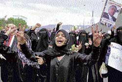Women take part in a march demanding the resignation of President Ali Abdullah Saleh in Sanaa on Monday. AP