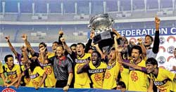 JUBILANT: Salgaocar players celebrate their Federation Cup triumph over East Bengal in Kolkata on Thursday. PTI