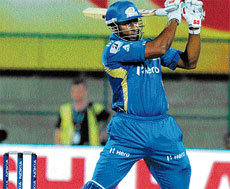 POWER-PACKED: Mumbai Indians' Kieron Pollard smashes one over the fence during his blistering innings of 58 against Cape Cobras at the Chinnaswamy stadium in Bangalore on Friday. DH Photo/ Kishor Kumar Bolar