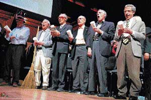Nobel Laureates, from left, Rich Roberts (Medicine, 2005), Roy Glauber (Physics, 2005), Dudley Herschbach (Chemistry, 1986), Lou Ignaro (Medicine, 1998), Peter Diamond (Economics, 2010) and Eric Maskin (Economics, 2007) perform at the 21st annual Ig Nobel Awards ceremony at Harvard University, Cambridge, Massachusetts, on Thursday. AP