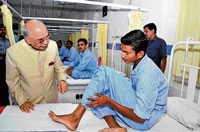 Governor H R Bhardwaj speaks to a patient at the Air Force Hospital on the celebration of the 79th Indian Air Force Day in Bangalore on Saturday. dh photo