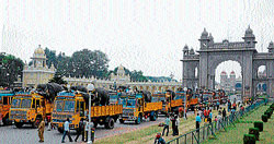 Dasara elephants on trucks leave palace in Mysore on Sunday, as curious people gather in large numbers to bid them adieu. dh photo