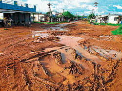 Pathetic: Road turns into slushy field in Beedi workers colony in Mandya. DH photo