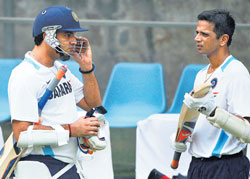 picking master's brain Yuvraj Singh (left) discusses a point with Rahul Dravid during India's net session at the Feroze Shah Kotla on Friday. AP
