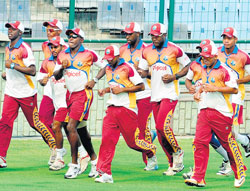 on a mission: West Indian players during a warm-up session at the Feroze Shah Kotla on Friday. AFP