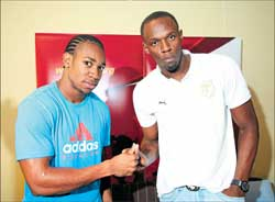 Fast men: Yohan Blake's progress in the 200M this year has been astounding, a fact acknowledged by Usain Bolt (right). AP