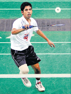Rohan Castelino of Aratt Fighters in action against B R Sankeerth of Li Ning Lions in the Karnataka Badminton League on Monday. DH PHOTO