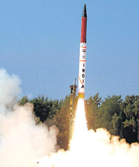 Agni IV, a strategic nuclear capable missile, being test-fired at Wheeler Island off the Odisha coast on Tuesday. PTI