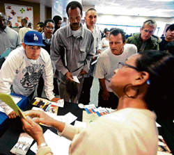 Unemployed Americans throng a job fair in the US, hoping for a better tomorrow. NYT