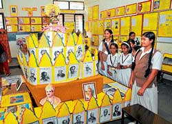 (Top) Students take a look at  colourful display of portraits of Kannada litterateurs at the school exhibition at Gnanaganga Vidyapeeta in Mysore on Saturday. DH Photo