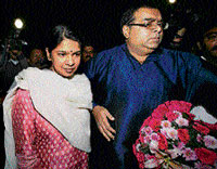 DMK MP Kanimozhi with her husband Aravindan after her release from the Tihar jail in New Delhi on Tuesday. PTI