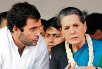 Congress General Secretary Rahul Gandhi speaks to his mother Sonia Gandhi during the Indian Youth Congress National Convention in New Delhi on Tuesday. AFP
