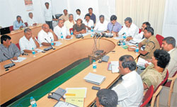 Road Map: District in-charge minister S A Ramdas, opposition leader Siddaramaiah chair a meeting on sand crisis at deputy commissioner's office in Mysore on Monday. MLAs H C Mahadevappa, Sathyanarayana, Chikkanna, S R Mahesh, H P Manjunath, Srinivasa Prasad, MLC Thontadarya, DC P S Vastrad, police commissioner Sunil Agarwal, SP Manish Karbiker, ZP CEO Sathyavathy, MUDA commissioner C G Betsurmath are seen. Dh Photo