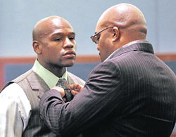troubled times Boxer Floyd Mayweather (left) with his manager Leonard Ellerbe during the hearing. Reuters