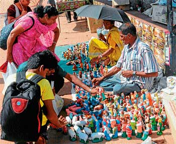 Street Vendors Selling Christmas Dolls Near Milagres DH Photo