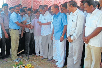 Urban development minister S Sureshkumar lays the foundation stone for implementation of second phase of underground drainage (UGD) works in K R Nagar, Mysore district, on Monday. District-in-charge minister S A Ramdas, MP Chaluvarayaswamy, MLA Sa Ra Mahesh and others are also seen. DH Photo