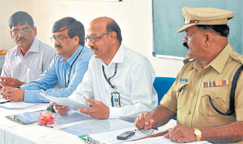 cooperation: Chief manager, Vijaya Bank, regional office, Pitambar Samantara, Corporation Bank, zonal office, senior manager K Ravindranath Naik, Lead Bank, chief manager, State Bank of Mysore, M B Chinnappa, senior manager and additional SP P Venkataswamy at a coordination meeting of police and banks in Mysore on Friday. DH Photo