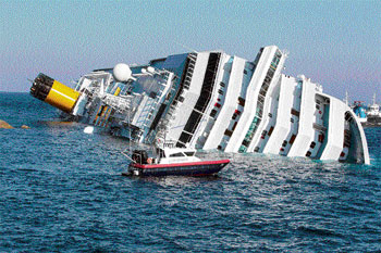 like Titanic: A Carabinieri boat approaches the luxury cruise ship Costa Concordia that ran aground off the tiny Tuscan island of Giglio on Saturday. AP
