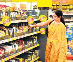 A customer scouts for groceries at one of the More Hypermarket stores in Bangalore. The retail chain has launched its own private label under the 'More' name. DH PHOTO/S K Dinesh