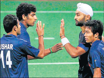 well done! Sandeep Singh (second from right) celebrates after scoring against South Africa in the second 'Test'. pti