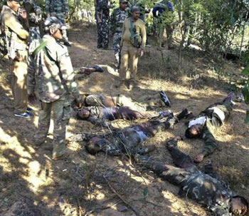 Bodies of policemen are seen after a landmine blast in the jungles of Bariganwa, in Jharkhand, India, Saturday, Jan. 21, 2012. Suspected Maoist rebels triggered a powerful landmine explosion Saturday killing 13 policemen in the eastern Indian state of Jharkhand, a top police official said. AP