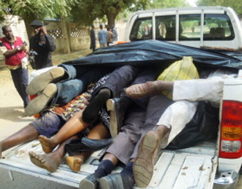 The bodies of victims killed by multiple explosions and armed assailants in the Marhaba area of the northern Nigerian city of Kano are piled up in a pick up truck to be sent to a morgue, on January 21, 2012. Coordinated bomb attacks on January 20 targeting security forces and gun battles have killed at least 121 people in Nigeria's second-largest city of Kano, with bodies littering the streets. AFP