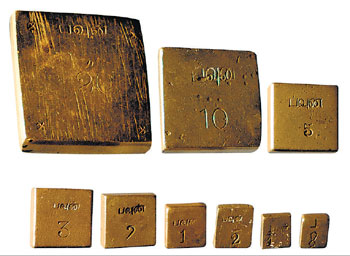 The old standard weights used for measuring gold