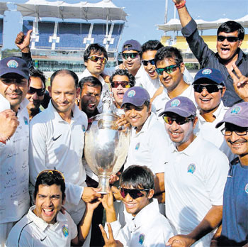 Clinical: Rajasthan players are ecstatic after becoming the fifth team to successfully defend their Ranji Trophy title. PTI