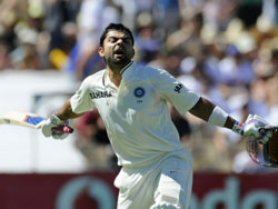 Virat Kohli celebrates his century against Australia during their cricket test match in Adelaide, Australia. AP