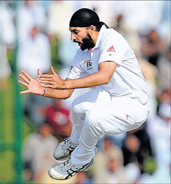 Monty Panesar exults after cleaning up  Younis Khan in the Abu Dhabi Test on Friday. AFP