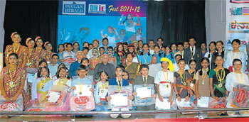 Winners of various competitions pose for a photograph with guests at the programme. The Printers (Mysore) Private Limited general manager (circulation) S Shivaramakrishna, Deccan Herald Mysore bureau chief N Niranjan Nikam, Mahajana Education Society president R Vasudevamurthy, Dy SP Dharanidevi Malagatti, G S Subrahmanya and assistant manager (circulation) Jagadeesh K Meti are seen.
